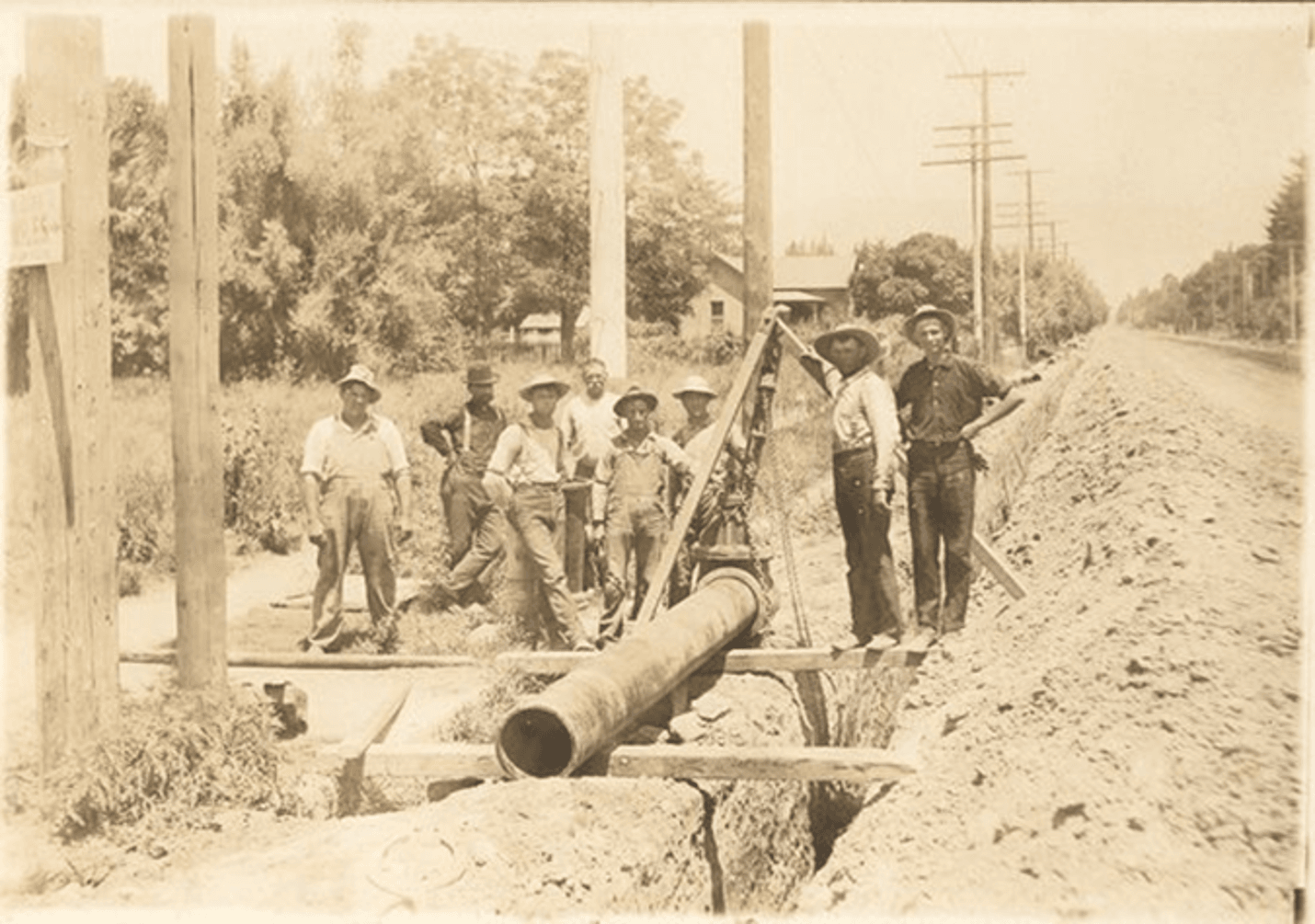 Water Department crew laying a pipe on 6th street in 1930s